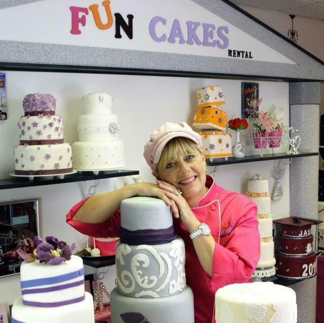 Kim leaning on cake